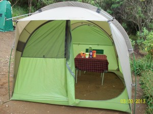 Machame Camp - first stop showing our mess tent with table laid for dinner.