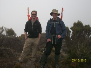 Jim and I leaving Machame Camp on day 2. Note the umbrellas which were very useful as we had some rain most afternoons.