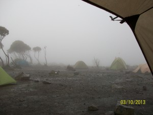 A very wet afternoon at Shira Camp peering out from our mess tent.
