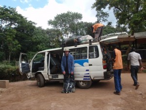 Me about to get into the mini-bus as the guys loaded everything on board at Mweka Gate - THE END!
